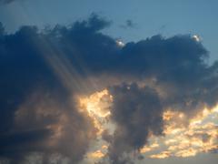 sunrays over sunset sky - stock photo