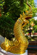 golden naga in thai temple - stock photo