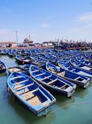 blue boats in essaouira, morocco - stock photo