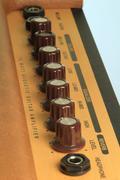 Dials on a guitar amp Stock Photos