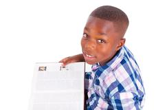 african american school boy reading a book - black people - stock photo
