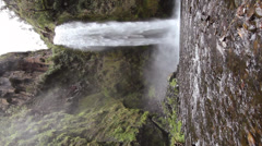 Large waterfall in a cloudforest valley near Quito, Ecuador - stock footage