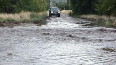 Flash flood across road vehicle stuck HD 9722 Stock Footage
