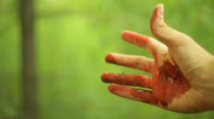 injured hand bloody woods 1 - stock footage