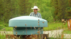 Rancher farmer checking water Stock Footage