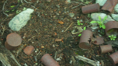 Rusty cans polluted garbage metal Stock Footage