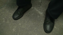 A man cleans shoes Stock Footage