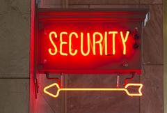 Red neon security sign indoor signage arrow pointing Stock Photos