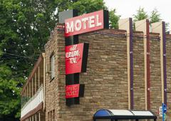 local motel downtown two story lodging travel accomodations bus route - stock photo