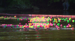 Rubber toy ducks floating on the river Stock Footage