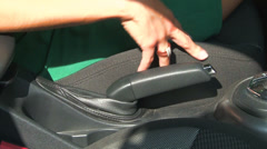 Handbrake in the car. A woman's hand. Stock Footage