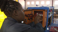 Stock Video Footage of Air Conditioner Recovery Unit Training Female Black Electrical PAL