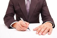 Stock Photo of Business worker signing the contract on white