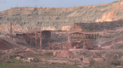 Heavy machinery working on open-pit mining operations Stock Footage