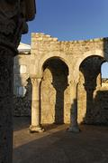 Stock Photo of ruins and columns by bell tower, church of st john (ivan) the evangelist, tow
