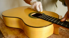 Luthier varnishing a flamenco guitar Stock Footage