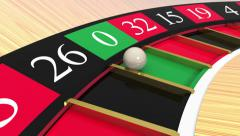 Close-Up of a Roulette wheel. Ball lands on Zero Stock Footage