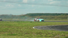 Auto racing. The smoke from under the tires - stock footage