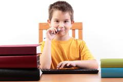 Young boy with books Stock Photos