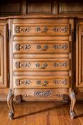 Antique wood carved chest of drawers Stock Photos