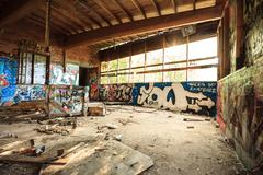 Abandoned warehouse in natural light - stock photo