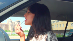 Brunette in the car moves makeup Stock Footage