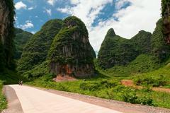 Road through karst limestone mountains in asia - stock photo