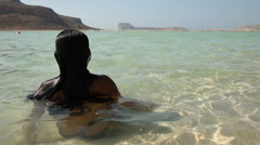 Relaxing woman in the ocean Stock Footage