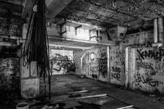 Dark abandoned scary factory room - stock photo