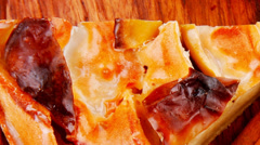 Stock Video Footage of sweet food : cuts of apple pie on wooden plate