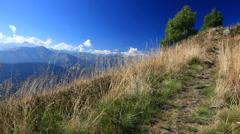 Hiker walking along a mountain trail. Stock Footage