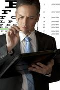 Businessman Has Trouble Seeing - stock photo