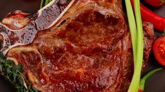 Meat food : grilled beef spare rib on dark dish Stock Footage