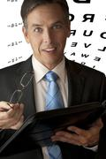 Businessman with Glasses and Eye Chart Stock Photos