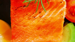 Roast salmon piece with tomatoes Stock Footage