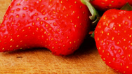 Stock Video Footage of raw ripe strawberry on wood