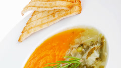 Dual components vegetable soup served with toasts Stock Footage