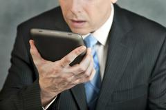 Businessman looks at tablet with despair Stock Photos