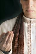 peaceful man in traditional indian clothing in prayer - stock photo
