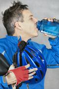 Cyclist takes a drink Stock Photos