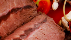 Beef on red plate over white Stock Footage