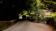 Stock Video Footage of Buckland in the Moor - Traditional Thatched Cottages 04