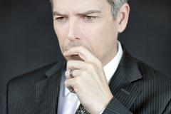businessman ponders - stock photo