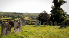 Old English Graveyard - Pan of Grave Stones Stock Footage
