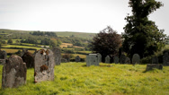 Stock Video Footage of Old English Graveyard - Pan of Grave Stones