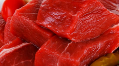 Meat slices in a white bowls Stock Footage