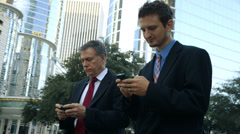 Businessmen texting in the city Stock Footage