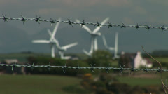 Barbed wire and wind turbines - stock footage