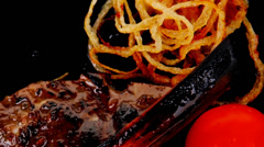 ribs on black with pepper - stock footage