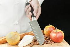 chef holds knife - stock photo